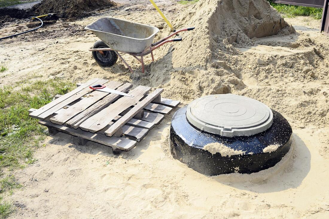 septic system worker doing septic repair