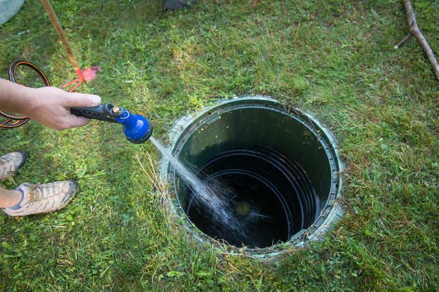 septic system worker doing septic pumping